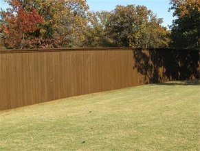 recently stained fence in Plano area